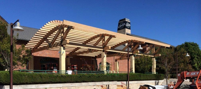 lidias restaurant exterior with curved truss pergola
