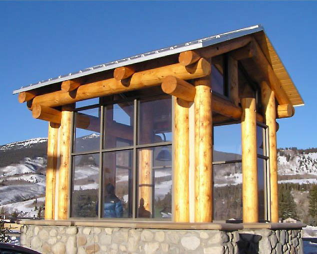 log post and beam covered bus stop in colorado