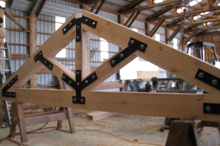 timber truss in shop with external steel plates