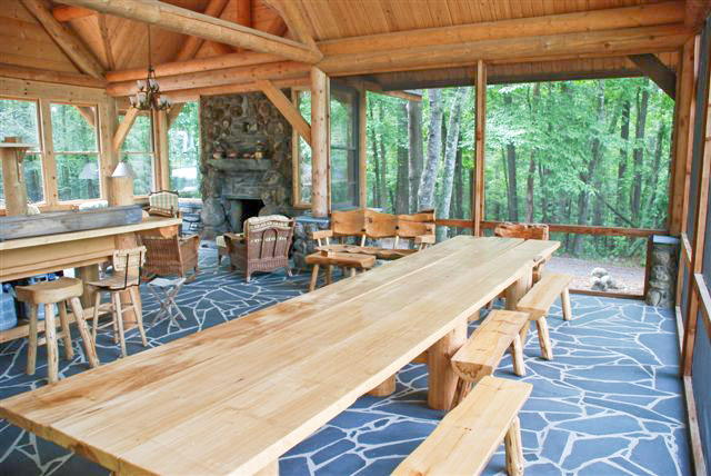 post and beam lake house with large dining table