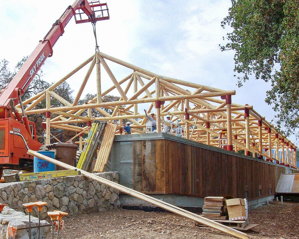 log truss roof installed by crane